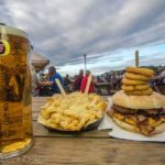 bbq burger with onion rings, cheesy chips and a pint