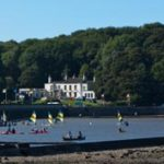 long distance shot of the salthouse pub and water