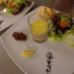 cheese fondant with bread and salad