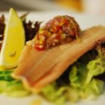 salmon fillet with salad and wedge of lemon
