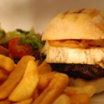cod burger with chips and salad