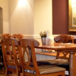 tables and chairs inside the salthouse restaurant