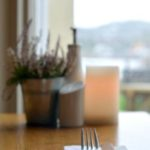 close up of knife and fork with table decoration